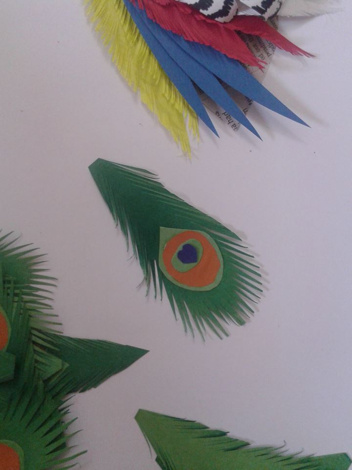 Peacock with paper