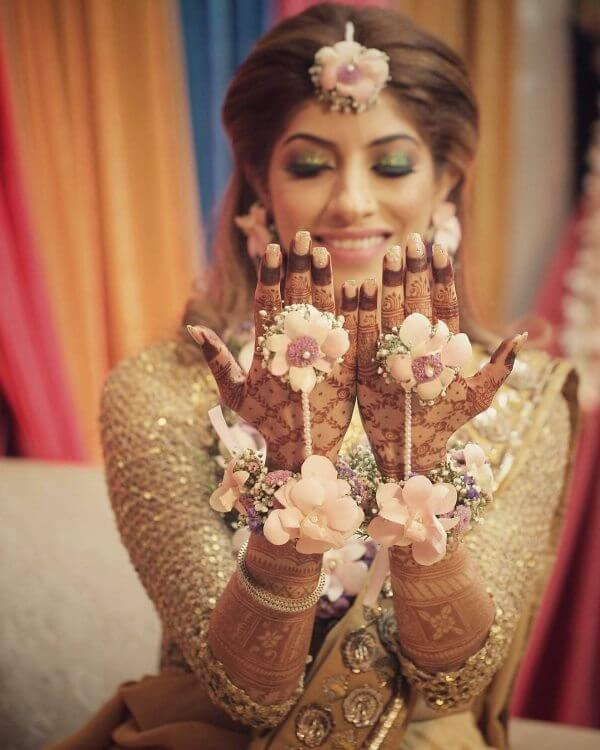 Bride in Baby pink colour flowers