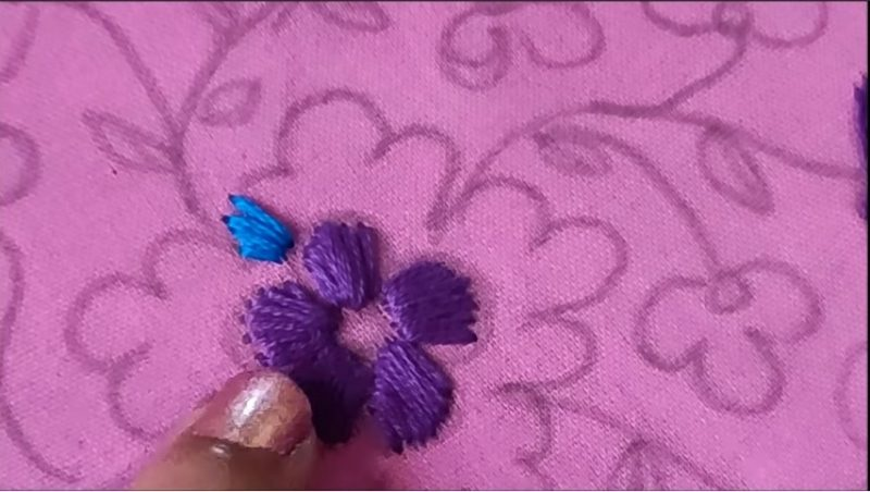 flower stitching with blue color thread