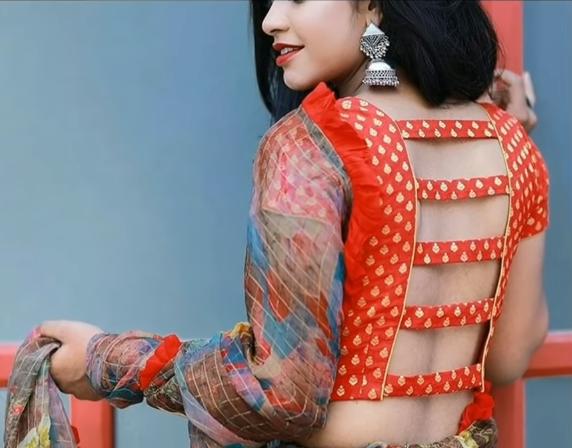 brocade orange blouse with designer back