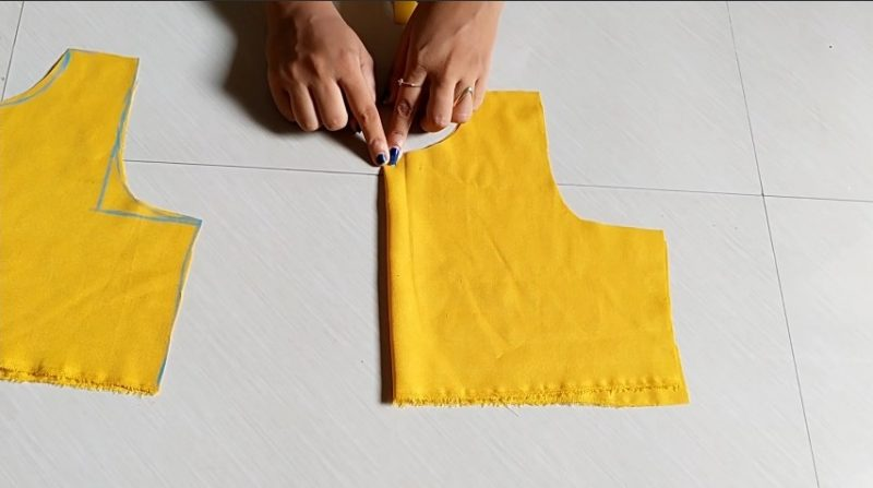 cutting the back portion of yellow cloth