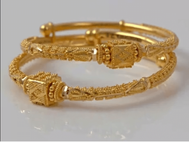 Exclusive gold bangles designs 11