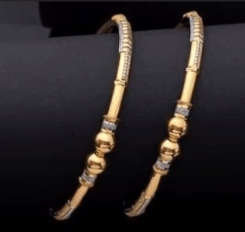 Exclusive gold bangles designs 13