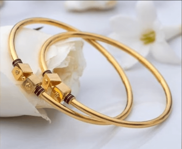 Exclusive gold bangles designs 15