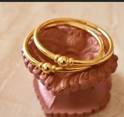 Exclusive gold bangles designs 25