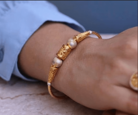 Exclusive gold bangles designs 28