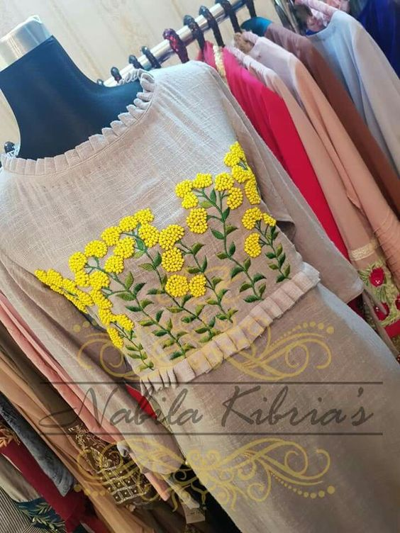 designer kurtha with embroidery and ruffles