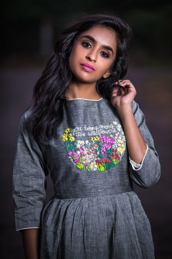 gray top with floral embroidery