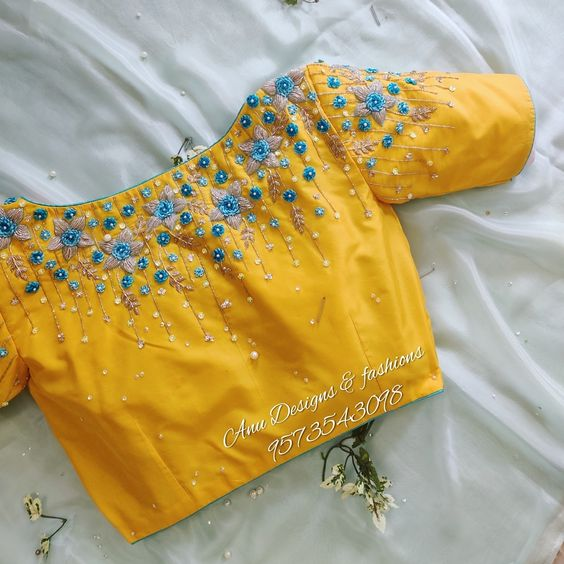 yellow blouse with blue floral embroidery