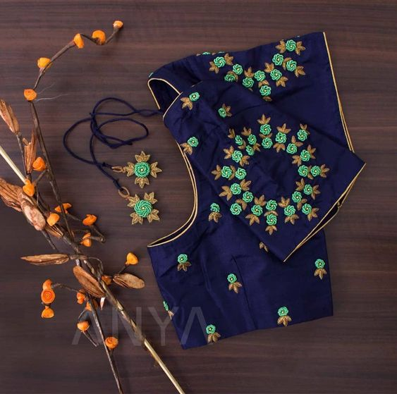 blue blouse with floral embroidery