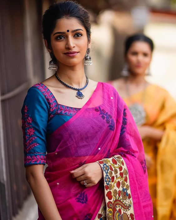blue blouse with pink saree