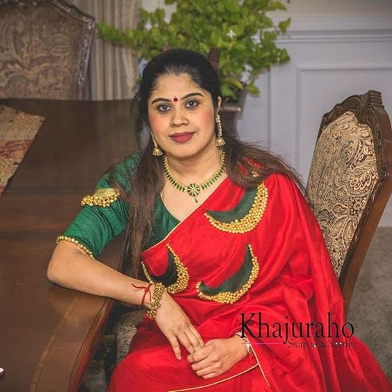 green blouse with red saree
