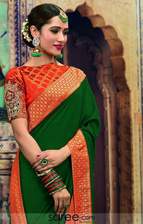 green silk saree matching orange designer blouse