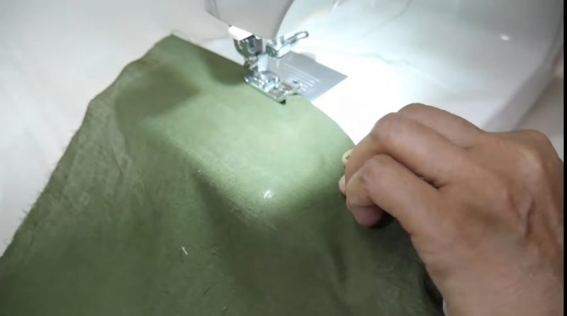sewing the neck with canvas paper
