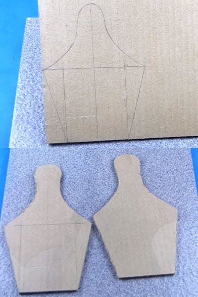 cutting the cardboard into the shape of bowling bottles