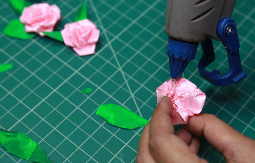 applying glue in rose flower