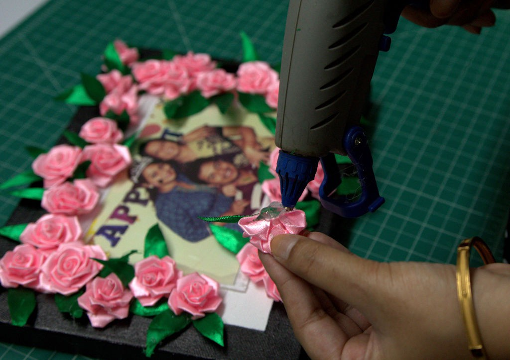 gluing roses to the frame
