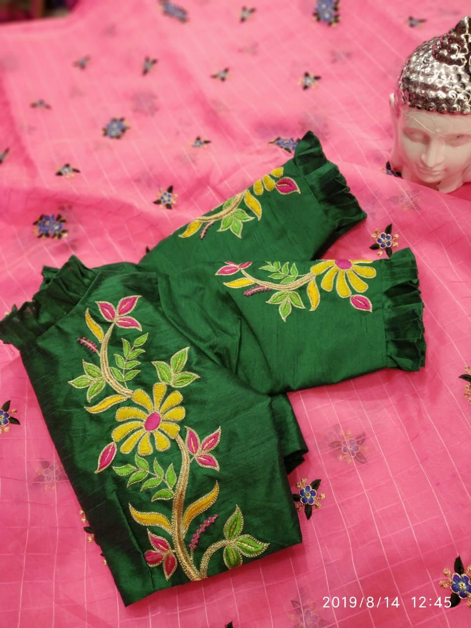 green blouse with ruffled high neck sleeve