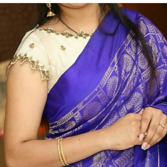 off-white blouse air with blue saree