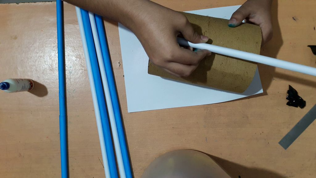 cover the cylindrical shape with paper sticks