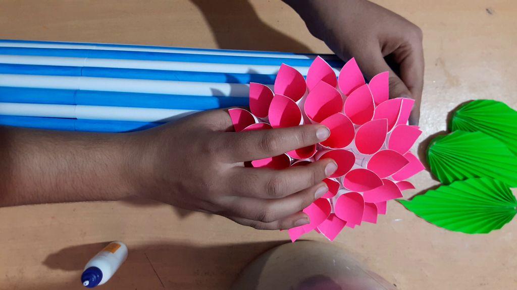 gluing flower on the vase