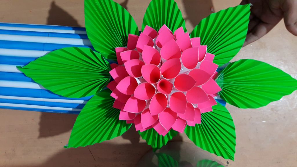 gluing leaves around the flower