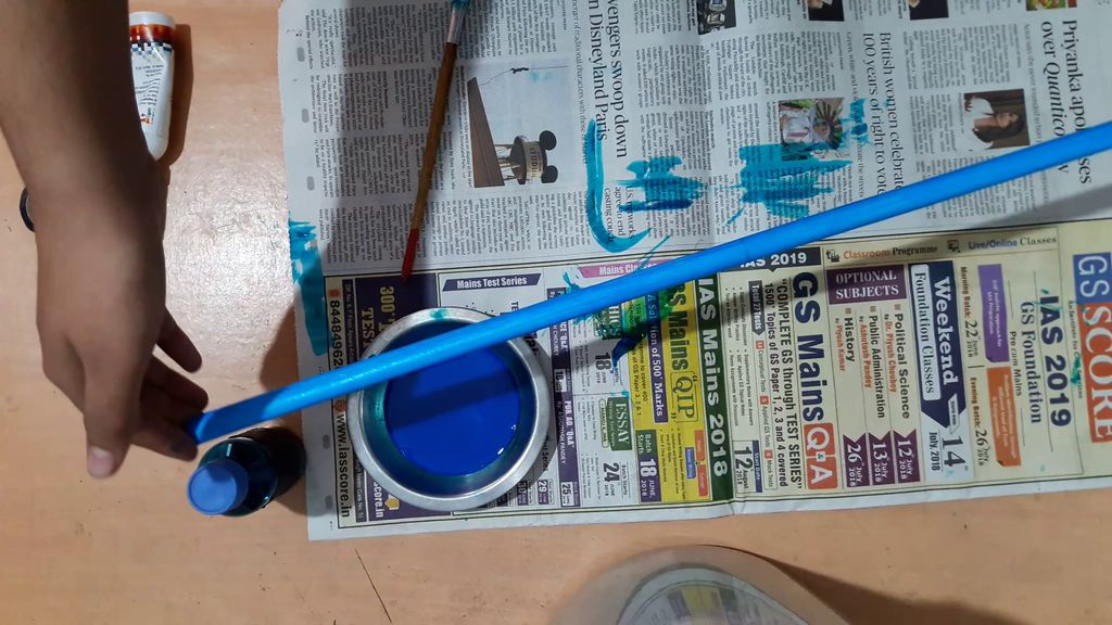 sticks painted with blue acrylic paint
