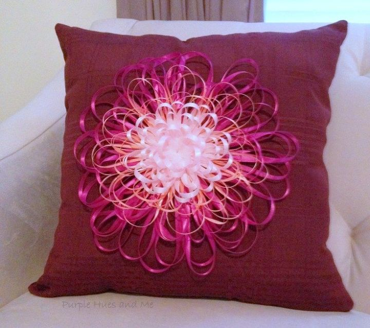 gluing the flower to the enter of the pillow