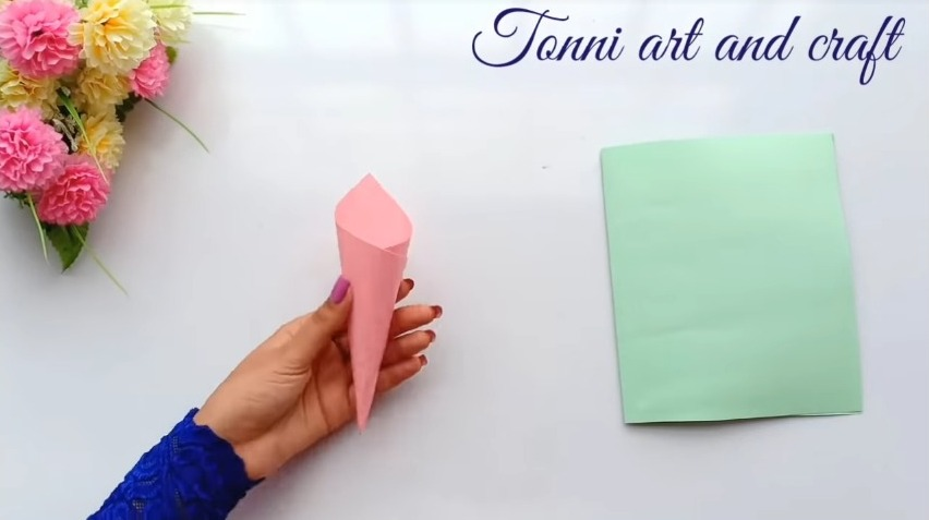 make a cone with the paper