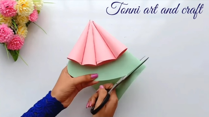 cut the paper to make the shape