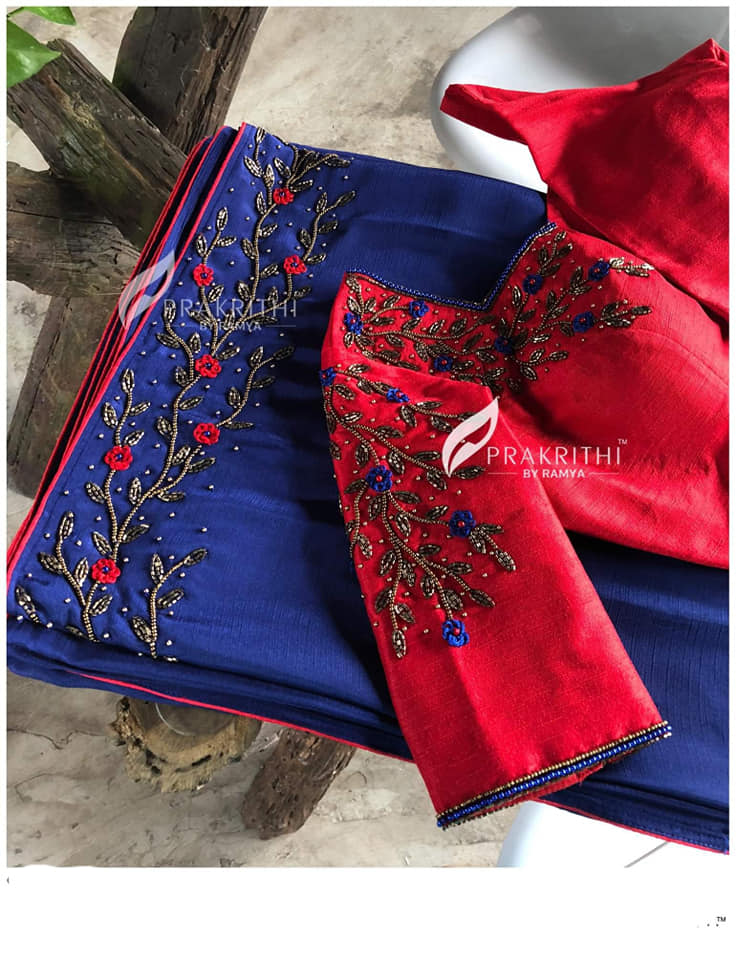 red Princess cut blouse with work on neck and sleeve