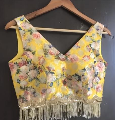 designer sleeveless blouse with hangings