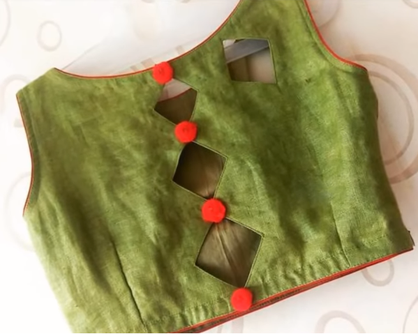 green blouse with back red buttons