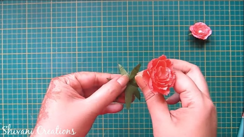 attach the flower with leaf