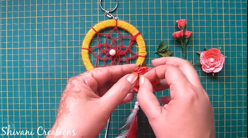 attach the flowers and leaves to the hoop