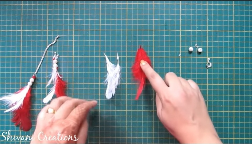 different color feathers with beads