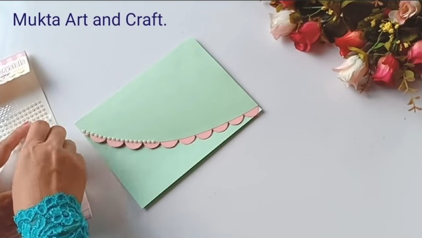 attaching white half pearls to the chart