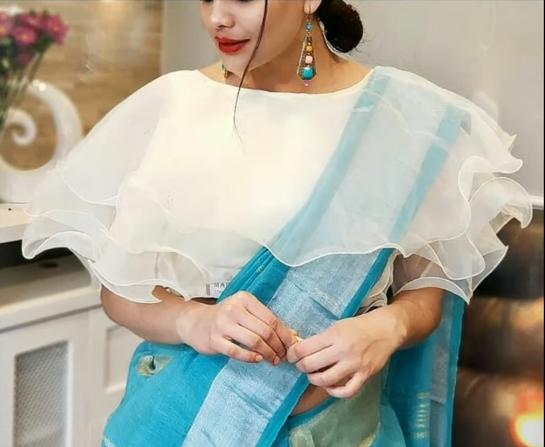 white ruffled blouse design
