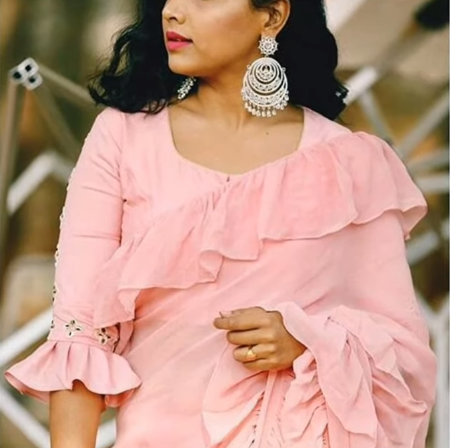 peach blouse with a bell sleeve
