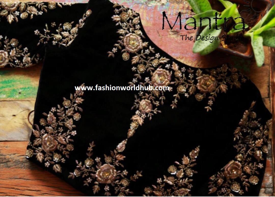 black boat neck blouse with floral design