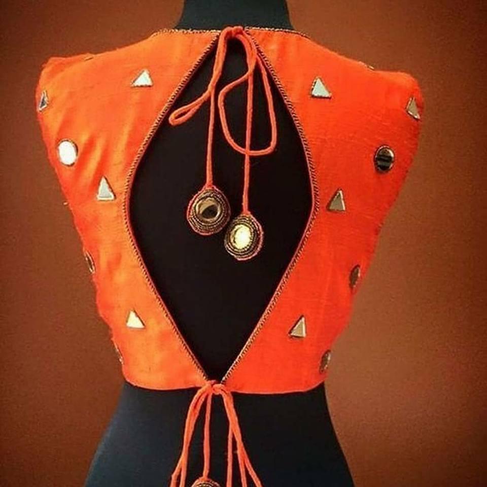 orange blouse with mirror work