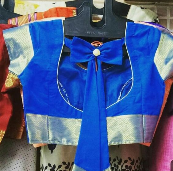blue blouse with a back bow