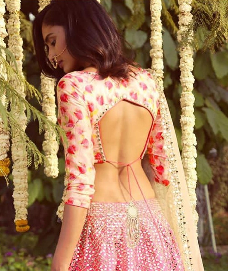 Printed lehenga blouse design with a low cut back