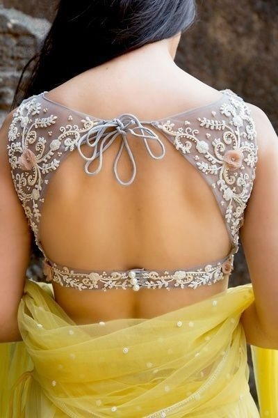 Open-back cut-out blouse design with embroidery