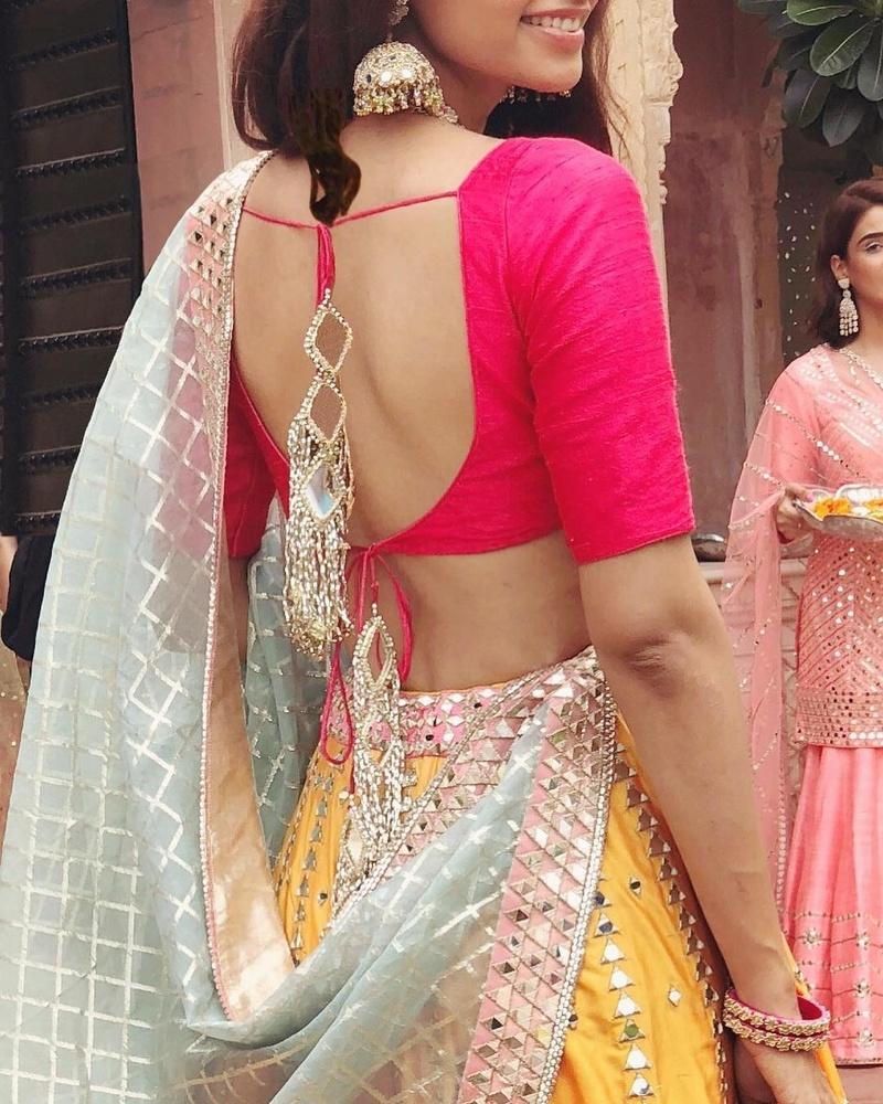 lehenga blouse design with low back and mirror latkan